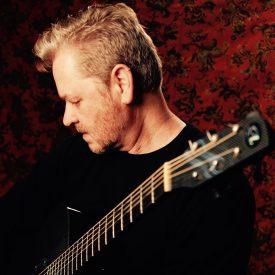 John Chisum with guitar